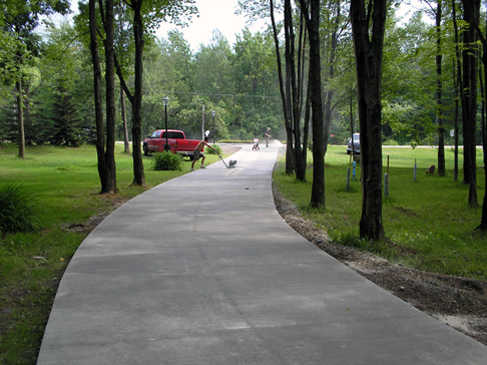 Akerly Concrete Construction has designed many driveways like this landscape-friendly, winding driveway, for Erie, PA area residences.